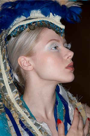 Side view fashion model wearing headgear looking away Stock Photo - Premium Royalty-Free, Code: 693-06325039