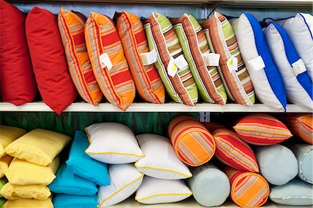 Multicolored cushions on display in store Stock Photo - Premium Royalty-Free, Code: 693-06325054