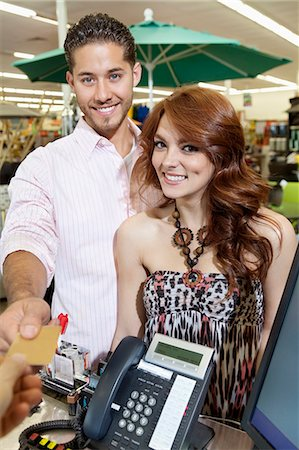person on phone with credit card - Portrait of a happy couple paying through credit card Stock Photo - Premium Royalty-Free, Code: 693-06325064