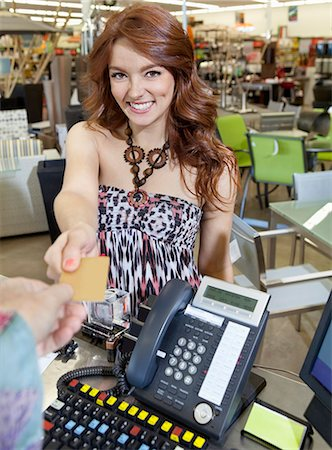 person on phone with credit card - Portrait of a happy young woman paying through credit card Stock Photo - Premium Royalty-Free, Code: 693-06325066