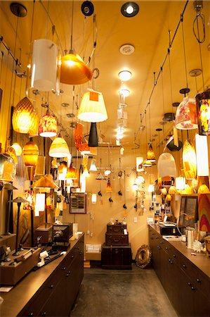 Lighting equipments on display in lights store Stock Photo - Premium Royalty-Free, Code: 693-06325133