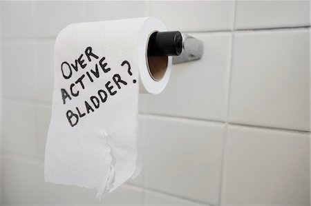 Close-up of toilet paper roll with text asking about bladder issues Stock Photo - Premium Royalty-Free, Code: 693-06325177