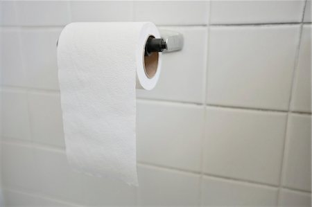 Close-up of tissue paper roll in bathroom Stock Photo - Premium Royalty-Free, Code: 693-06325173