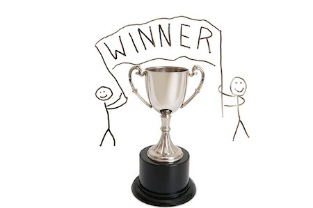 Trophy over stick figure drawing on whiteboard Stock Photo - Premium Royalty-Free, Code: 693-06325182