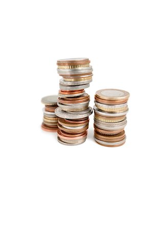 Stack of coins over white background Stock Photo - Premium Royalty-Free, Code: 693-06325201