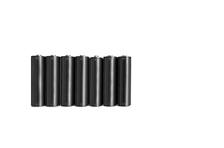 Close-up of black batteries over white background Stock Photo - Premium Royalty-Free, Code: 693-06325219