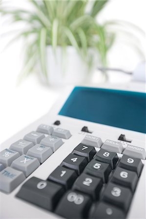 Close-up of calculator in office Stock Photo - Premium Royalty-Free, Code: 693-06325228