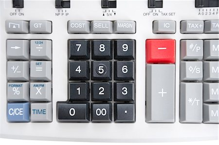 Close-up of pushbuttons of calculator Stock Photo - Premium Royalty-Free, Code: 693-06325229