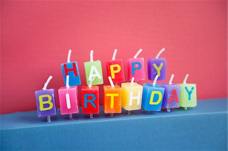 Unlit birthday candles over colored background Stock Photo - Premium Royalty-Free, Code: 693-06325231