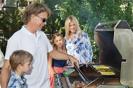recreation - Family of four barbecuing Stock Photo - Premium Royalty-Free, Code: 693-06378801