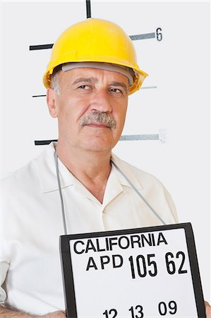 Mug shot of senior male constructor looking away Stock Photo - Premium Royalty-Free, Code: 693-06378943