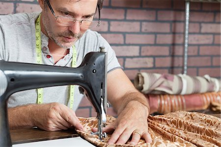 professional (pertains to traditional blue collar careers) - Mature male tailor stitching cloth on sewing machine Stock Photo - Premium Royalty-Free, Code: 693-06378999