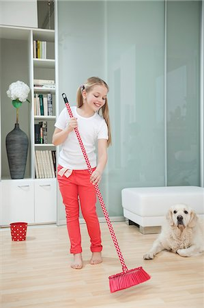 Girl sweeping the floor Stock Photo - Premium Royalty-Free, Code: 693-06379431