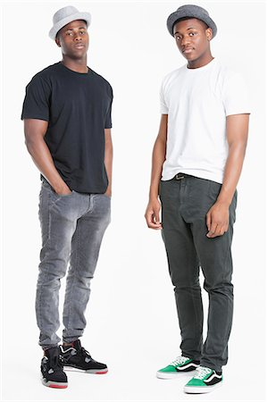 Portrait of two young African American men in casuals over gray background Stock Photo - Premium Royalty-Free, Code: 693-06379526