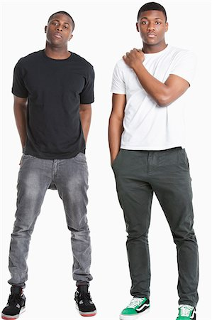 Portrait of two young men in casuals over gray background Stock Photo - Premium Royalty-Free, Code: 693-06379523