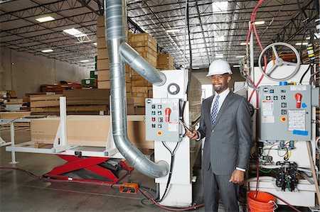 Portrait of an African American male engineer in timber factory Stock Photo - Premium Royalty-Free, Code: 693-06379758
