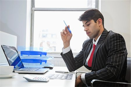east indian (male) - An Indian businessman working at office desk Stock Photo - Premium Royalty-Free, Code: 693-06379803