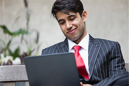 east indian (male) - An Indian businessman using tablet PC Stock Photo - Premium Royalty-Free, Code: 693-06379818