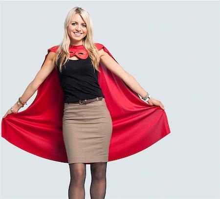 superhero costume - Portrait of beautiful woman in superhero costume over light blue background Stock Photo - Premium Royalty-Free, Code: 693-06379905