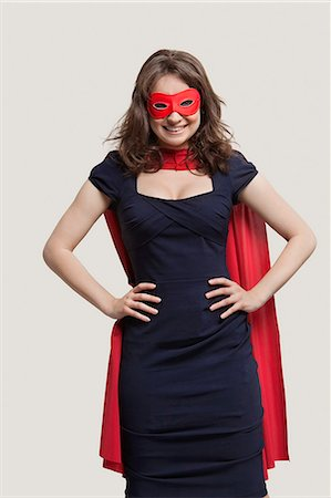 superhero costume - Portrait of a young woman in superhero costume over gray background Stock Photo - Premium Royalty-Free, Code: 693-06380088