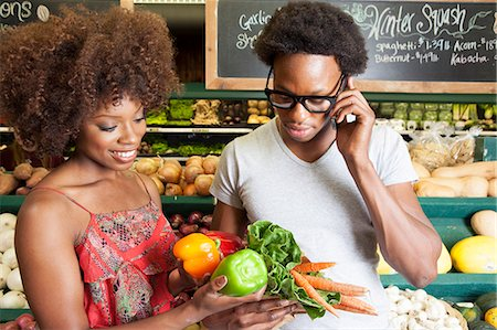 sale - Young African American couple buying vegetables at supermarket Stock Photo - Premium Royalty-Free, Code: 693-06403167