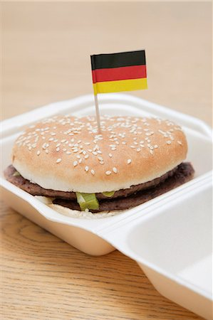 delicious - Fresh hamburger with German flag decoration on wooden surface Stock Photo - Premium Royalty-Free, Code: 693-06403333