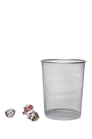 Crumpled papers next to empty wastebasket over white background Stock Photo - Premium Royalty-Free, Code: 693-06403374