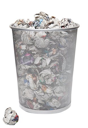 Wastepaper basket with papers lying over white background Stock Photo - Premium Royalty-Free, Code: 693-06403379