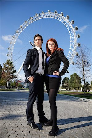 Portrait of confident young business couple standing together against London Eye, London, UK Stock Photo - Premium Royalty-Free, Code: 693-06435875