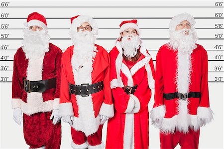 People in Santa costume standing side by side against police lineup Stock Photo - Premium Royalty-Free, Code: 693-06435897