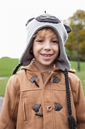 Portrait of cute boy in winter clothing at park Stock Photo - Premium Royalty-Free, Code: 693-06435952