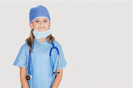 dress up girl - Portrait of young girl in surgeon's costume against gray background Stock Photo - Premium Royalty-Free, Code: 693-06436060