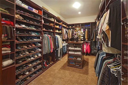 Walk in closet with organized clothing Stock Photo - Premium Royalty-Free, Code: 693-06667907