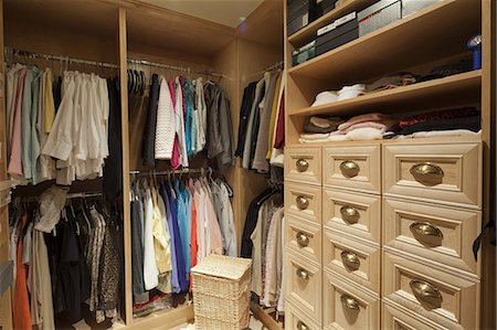 Walk in closet with organized clothing Stock Photo - Premium Royalty-Free, Code: 693-06667915