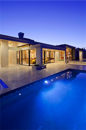 Rear view of luxury villa at night time with swimming pool Stock Photo - Premium Royalty-Free, Code: 693-06667916