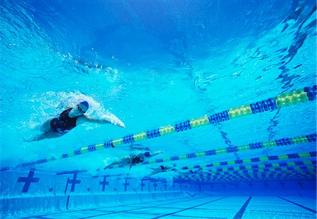 swimming pool water - Four female professional participants racing in pool Stock Photo - Premium Royalty-Free, Code: 693-06668089