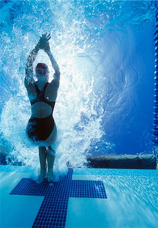 Rear view of female swimmer in competition Stock Photo - Premium Royalty-Free, Code: 693-06668080