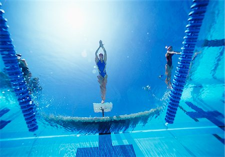 swimming pool water - View of female swimmer diving in swimming pool Stock Photo - Premium Royalty-Free, Code: 693-06668083