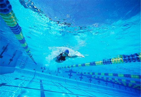 swimming pool water - Young female swimmer in competition Stock Photo - Premium Royalty-Free, Code: 693-06668095