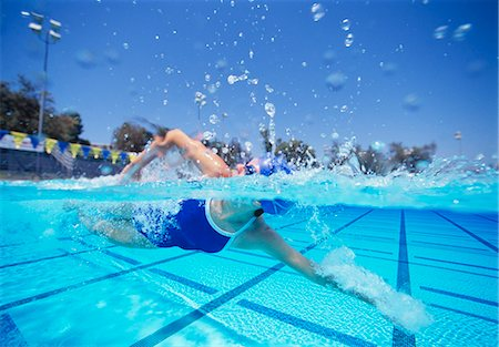 swimming pool water - Female swimmer in United States swimsuit swimming in pool Stock Photo - Premium Royalty-Free, Code: 693-06668098