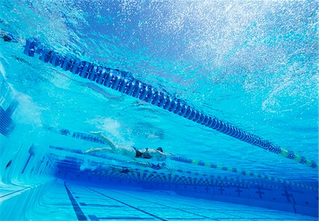 swimming pool water - Swimmers racing together in swimming pool Stock Photo - Premium Royalty-Free, Code: 693-06668091