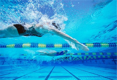 swimming pool water - Four female swimmers racing together in swimming pool Stock Photo - Premium Royalty-Free, Code: 693-06668093