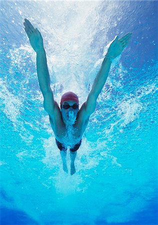 swimming - Professional young male athlete swimming in pool Stock Photo - Premium Royalty-Free, Code: 693-06668104