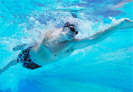 swimming - Underwater shot of professional male athlete swimming in pool Stock Photo - Premium Royalty-Free, Code: 693-06668105
