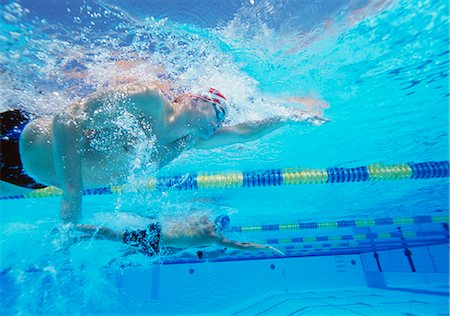 swimming pool water - Underwater shot of three male athletes in swimming competition Stock Photo - Premium Royalty-Free, Code: 693-06668109
