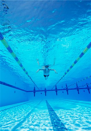 swimming pool water - Underwater shot of male athlete swimming in pool Stock Photo - Premium Royalty-Free, Code: 693-06668110