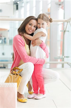 people on mall - Mother and daughter hugging Stock Photo - Premium Royalty-Free, Code: 693-06967419