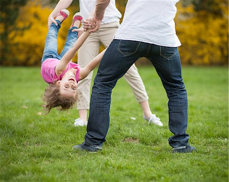 Young couple swinging daughter between them Stock Photo - Premium Royalty-Free, Code: 693-06967441