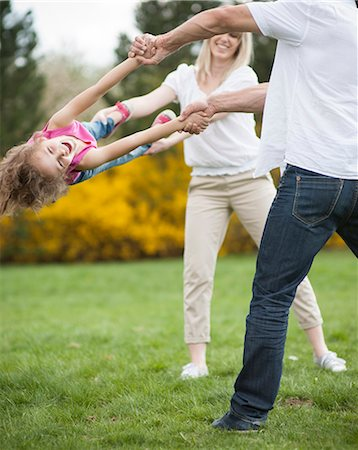 swing (sports) - Young couple swinging daughter between them Stock Photo - Premium Royalty-Free, Code: 693-06967442