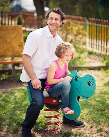 Father and daughter on playground spring rider Stock Photo - Premium Royalty-Free, Code: 693-06967456